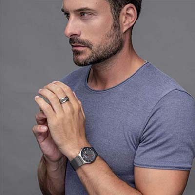 Model with men's watch on the wrist by Bering in silver with solar function
